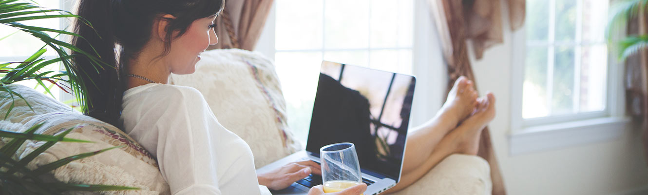 Woman using computer in living room